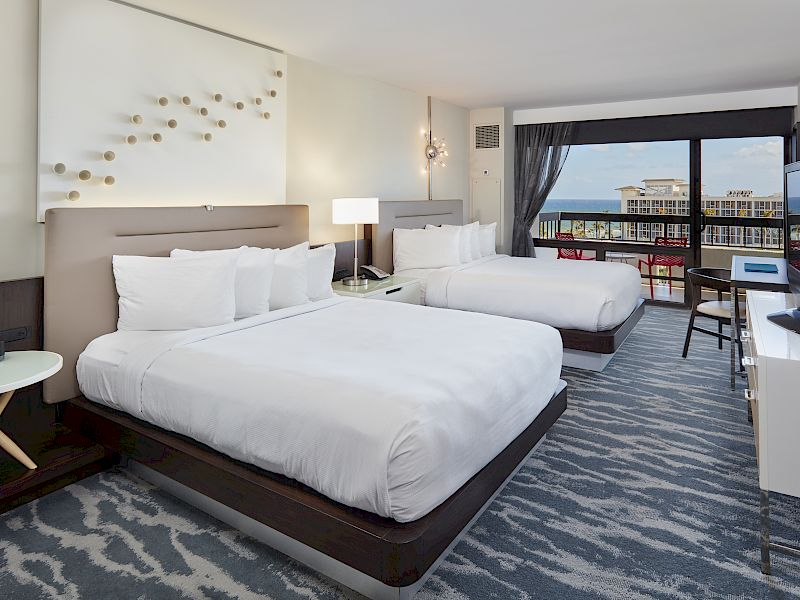 Two queen bed in room with ocean views