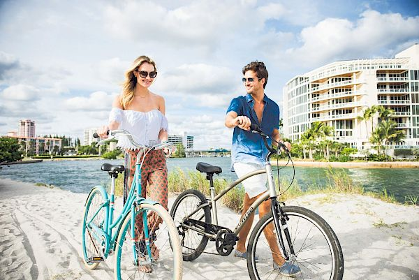 A couple enjoying the use of on-site rental bikes.